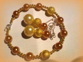 Bransoletka i kolczyki z koralików Złote kulki kuleczki :D