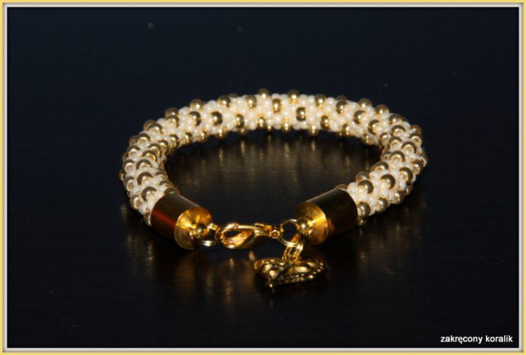 Wężowa bransoletka perłowo - złota