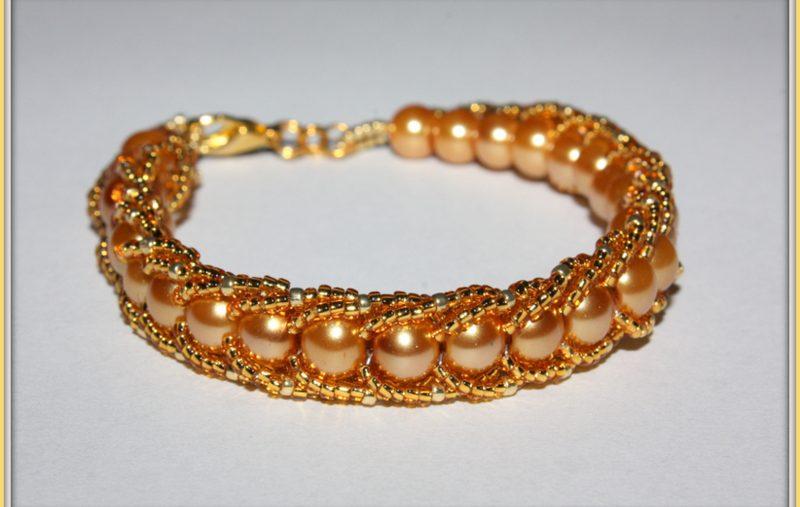 """""""W blasku zlota"""" bransoletka flat spiral wykonana z perełek i koralików drobnych TOHO."""